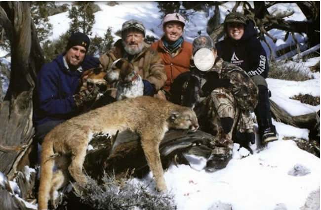 Photo ofNicholaus Rodgers, Chirstopher Loncarich and his daughters Andie and Caitlin, with unidentified hunter and mountain lion. - photo by U.S. Fish and Wildlife Service